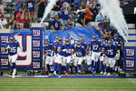 The New York Giants take the field before an NFL preseason football game against the New York Jets, Saturday, Aug. 14, 2021, in East Rutherford, N.J. (AP Photo/Frank Franklin II)