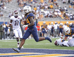 West Virginia running back Tony Mathis Jr. (24) rushes in for a touchdown against Eastern Kentucky during an NCAA college football game Saturday, Sept. 12, 2020, in Morgantown, W.Va. (William Wotring/The Dominion-Post via AP)