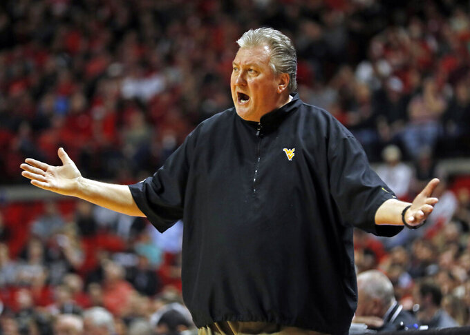 West Virginia coach Bob Huggins yells out at the referees during the first half of an NCAA college basketball game against Texas Tech, Monday, Feb. 4, 2019, in Lubbock, Texas. (AP Photo/Brad Tollefson)