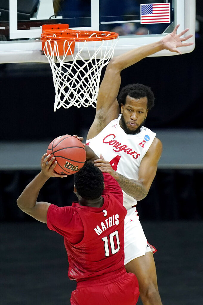 Rutgers' Montez Mathis (10) drives against Houston's Justin Gorham (4) during the first half of a college basketball game in the second round of the NCAA tournament at Lucas Oil Stadium in Indianapolis Sunday, March 21, 2021. (AP Photo/Mark Humphrey)