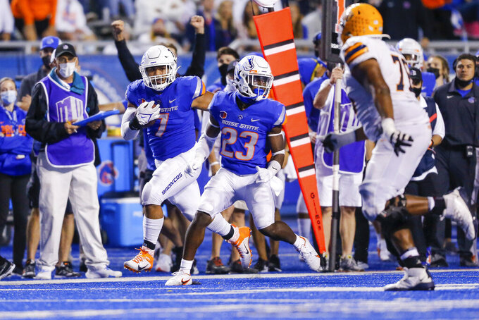 Boise State linebacker Ezekiel Noa (7) runs with the ball behind the blocking of safety Seyi Oladipo (23) after a fumble by UTEP during the second half of an NCAA college football game Friday, Sept. 10, 2021, in Boise, Idaho. (AP Photo/Steve Conner)
