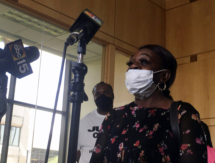Erma Johnson, the mother of Dion Johnson, speaks at a news conference in Phoenix on Friday, June 5, 2020. The family of Dion Johnson, an unarmed man shot and killed by an Arizona state trooper the same day George Floyd died, said Friday they want a federal investigation. (AP Photo/Terry Tang)