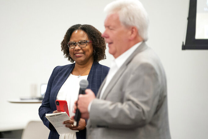 Maria Reeve, background, is named the executive editor of the Houston Chronicle, as Chronicle publisher John McKeon, foreground, speaks Tuesday, July 20, 2021, at the Chronicle's Houston office. (Mark Mulligan/Houston Chronicle via AP)