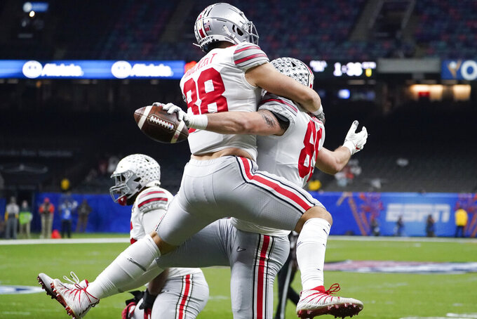 Ohio State tight end Luke Farrell celebrates after scoring with tight end Jeremy Ruckert during the first half of the Sugar Bowl NCAA college football game against Clemson Friday, Jan. 1, 2021, in New Orleans. (AP Photo/John Bazemore)