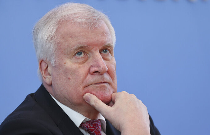 German Interior Minister Horst Seehofer, attends a news conference on politically motivated crimes in Berlin, Germany, Wednesday, May 27, 2020. (Fabrizio Bensch/Pool via AP)