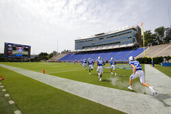 Duke players runs onto the field before an NCAA college football game against the Boston College Saturday, Sept. 19, 2020, in Durham, N.C. (Nell Redmond/Pool Photo via AP)