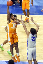 Tennessee's E.J. Anosike, left, shoots as Kentucky's Lance Ware defends during the first half of an NCAA college basketball game in Lexington, Ky., Saturday, Feb. 6, 2021. (AP Photo/James Crisp)