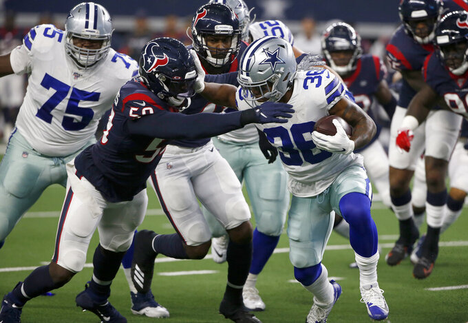 Houston Texans outside linebacker Whitney Mercilus, left, attempts to stop Dallas Cowboys running back Tony Pollard (36) from advancing the ball in the first half of a preseason NFL football game in Arlington, Texas, Saturday, Aug. 24, 2019. (AP Photo/Ron Jenkins)