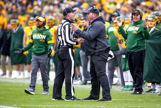 North Dakota State head coach Matt Entz speaks with an official after a touchdown scored by his team was overturned in the first half of the FCS championship NCAA college football game against James Madison, Saturday, Jan. 11, 2020, in Frisco, Texas. (AP Photo/Sam Hodde)