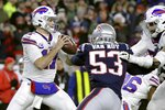 Buffalo Bills quarterback Josh Allen, left, drops back to pass under pressure from New England Patriots linebacker Kyle Van Noy in the second half of an NFL football game, Saturday, Dec. 21, 2019, in Foxborough, Mass. (AP Photo/Elise Amendola)