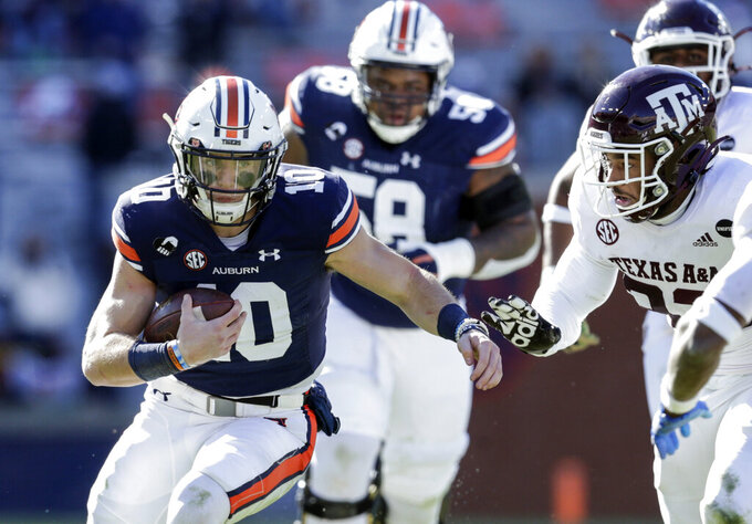 Auburn quarterback Bo Nix (10) scrambles for yardage during the second half of an NCAA college football game against Texas A&M on Saturday, Dec. 5, 2020, in Auburn, Ala. (AP Photo/Butch Dill)