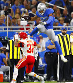 Detroit Lions tight end Logan Thomas (82) attempts a jump over Kansas City Chiefs strong safety Tyrann Mathieu (32) during the second half of an NFL football game, Sunday, Sept. 29, 2019, in Detroit. (AP Photo/Paul Sancya)