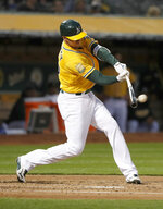 Oakland Athletics' Stephen Piscotty (25) hits a double against the Chicago White Sox during the second inning of a baseball game Monday, April 16, 2018, in Oakland, Calif. (AP Photo/Tony Avelar)
