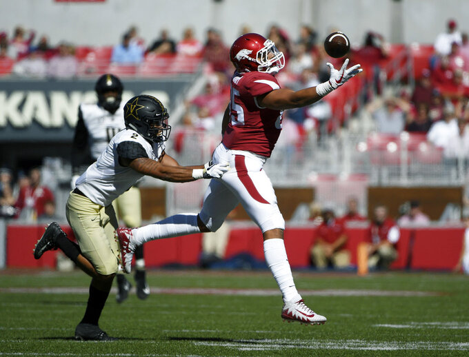 Arkansas tight end Cheyenne O'Grady makes a one handed catch in front of Vanderbilt defensive back Frank Coppet in the first half of an NCAA college football game Saturday, Oct. 27, 2018, in Fayetteville, Ark. (AP Photo/Michael Woods)