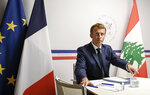 France's President Emmanuel Macron attends an international video conference at the Fort de Bregancon, in Bormes-Les-Mimosas, southern France, Wednesday, Aug. 4, 2021. The virtual event, co-hosted by France and the United Nations, is meant to show support towards Lebanese people, French President Emmanuel Macron said. France will provide 100 millions euros ($118.6 million) in the coming months, Macron said in his opening remarks. (Christophe Simon/Pool Photo via AP)