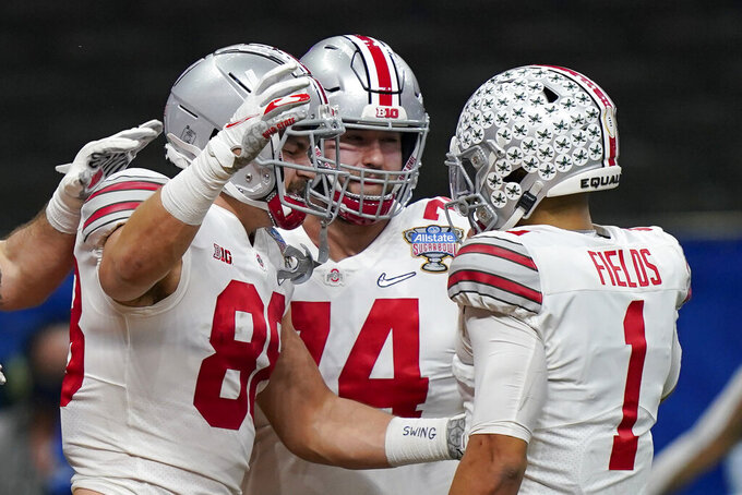 Ohio State tight end Jeremy Ruckert, left, celebrates his touchdown with quarterback Justin Fields during the first half of the Sugar Bowl NCAA college football game against Clemson Friday, Jan. 1, 2021, in New Orleans. (AP Photo/Gerald Herbert)