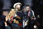 John Osborne, left, and T.J. Osborne of the Brothers Osborne musical duo perform during halftime of an NFL football game between the Detroit Lions and the Chicago Bears, Thursday, Nov. 28, 2019, in Detroit. (AP Photo/Rick Osentoski)