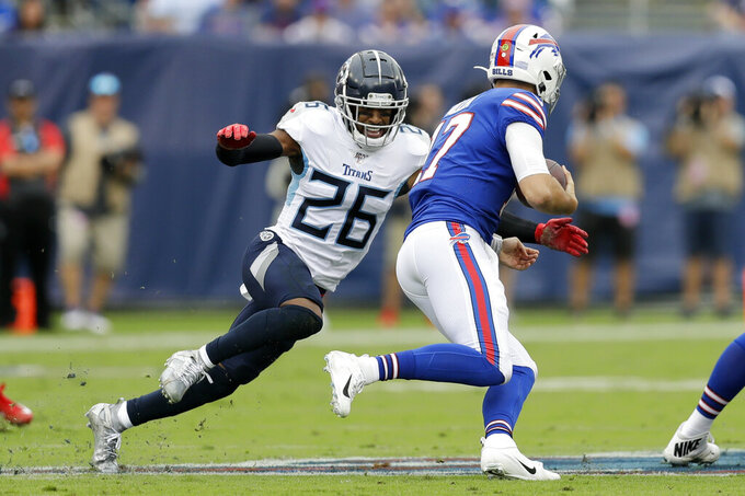 Tennessee Titans cornerback Logan Ryan (26) closes in on Buffalo Bills quarterback Josh Allen (17) in the first half of an NFL football game Sunday, Oct. 6, 2019, in Nashville, Tenn. (AP Photo/James Kenney)