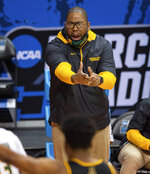 Norfolk State head coach Robert Jones reacts to the action on the court during the first half of a First Four game against Appalachian State in the NCAA men's college basketball tournament, Thursday, March 18, 2021, in Bloomington, Ind. (AP Photo/Doug McSchooler)