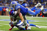 New York Giants tight end Rhett Ellison is tackled by Detroit Lions middle linebacker Jarrad Davis (40) during the second half of an NFL football game, Sunday, Oct. 27, 2019, in Detroit. (AP Photo/Paul Sancya)