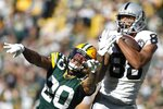 Oakland Raiders' Marcell Ateman catches a pass in front of Green Bay Packers' Kevin King during the second half of an NFL football game Sunday, Oct. 20, 2019, in Green Bay, Wis. (AP Photo/Jeffrey Phelps)