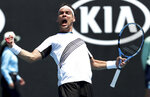 Italy's Fabio Fognini celebrates after defeating Reilly Opelka of the U.S. in their first round singles match at the Australian Open tennis championship in Melbourne, Australia, Tuesday, Jan. 21, 2020. (AP Photo/Dita Alangkara)