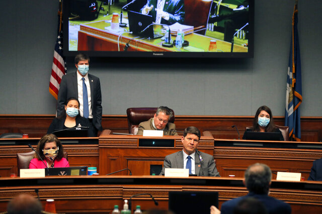 Members of the Louisiana House Appropriations Committee, some wearing masks and other not, listen to testimony by state commissioner of administration Jay Dardenne, in Baton Rouge, La., Monday, May 4, 2020. (AP Photo/Gerald Herbert)