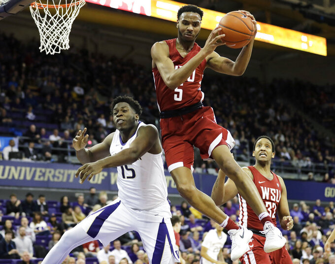 Washington State guard Marvin Cannon (5) grabs a rebound above Washington forward Noah Dickerson (15) during the first half of an NCAA college basketball game, Saturday, Jan. 5, 2019, in Seattle. (AP Photo/Ted S. Warren)