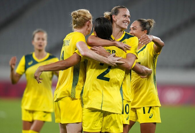 Australia's Sam Kerr (2) celebrates with her teammates after scoring her side's 2nd goal during a women's soccer match against New Zealand at the 2020 Summer Olympics, Wednesday, July 21, 2021, in Tokyo. (AP Photo/Ricardo Mazalan)