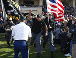 Army head coach Jeff Monken, center, leads his team onto the field prior to the Armed Forces Bowl NCAA college football game against Houston, Saturday, Dec. 22, 2018, in Fort Worth, Texas. (AP Photo/Jim Cowsert)