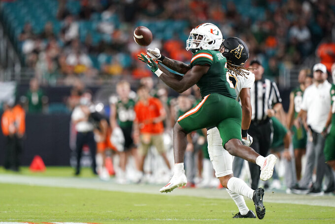 Miami cornerback Tyrique Stevenson attempts to intercept a pass intended for Appalachian State wide receiver Corey Xavier Sutton during the second half of an NCAA college football game Saturday, Sept. 11, 2021, in Miami Gardens, Fla. The pass was incomplete. (AP Photo/Wilfredo Lee)