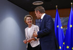 Germany's Ursula von der Leyen is welcomed by European Council President Donald Tusk prior to a meeting at the Europa building in Brussels, Thursday July 4, 2019. European Union leaders have nominated Germany's Ursula von der Leyen to become the next president of the European Commission. (Francois Lenoir, Pool Photo via AP)