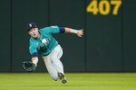 Seattle Mariners center fielder Jarred Kelenic lays out to catch a fly ball hit by Texas Rangers' Nathaniel Lowe in the seventh inning of a baseball game in Arlington, Texas, Tuesday, Aug. 17, 2021. (AP Photo/Tony Gutierrez)