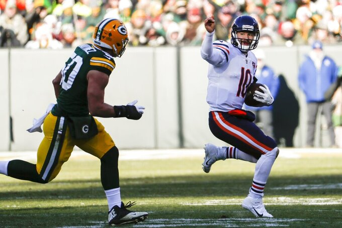 Chicago Bears' Mitchell Trubisky tries to run past Green Bay Packers' Blake Martinez during the first half of an NFL football game Sunday, Dec. 15, 2019, in Green Bay, Wis. (AP Photo/Matt Ludtke)