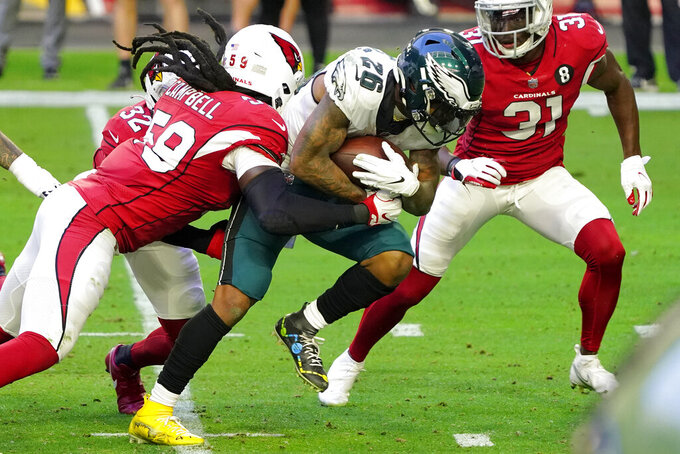 Philadelphia Eagles running back Miles Sanders (26) runs the ball as Arizona Cardinals outside linebacker De'Vondre Campbell (59) makes the tackle during the first half of an NFL football game, Sunday, Dec. 20, 2020, in Glendale, Ariz. (AP Photo/Rick Scuteri)