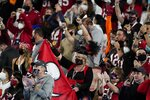 Fans cheer before the first half of the NFL Super Bowl 55 football game between the Kansas City Chiefs and the Tampa Bay Buccaneers, Sunday, Feb. 7, 2021, in Tampa, Fla. (AP Photo/Ashley Landis)