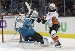 San Jose Sharks goalie Martin Jones, left, defends the goal against Anaheim Ducks left wing Andrew Cogliano (7) during the second period of Game 3 of an NHL hockey first-round playoff series in San Jose, Calif., Monday, April 16, 2018. (AP Photo/Jeff Chiu)