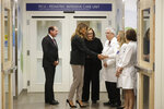 First lady Melania Trump, second from left, greets Pediatric Intensive Care Unit nurse manager Karan Barry, second from right, as U.S. Secretary of Health and Human Services Alex Azar, left, President and CEO of Boston Medical Center Kate Walsh, third from left, Chief of Pediatrics Bob Vinci, third from right, and pediatrician Eileen Costello, right, look on during a visit to Boston Medical Center, in Boston, Wednesday, Nov. 6, 2019. The visit, part of the first lady's