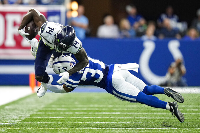 Seattle Seahawks wide receiver DK Metcalf (14) is tackled by Indianapolis Colts safety Khari Willis (37) during the second half of an NFL football game in Indianapolis, Sunday, Sept. 12, 2021. (AP Photo/AJ Mast)