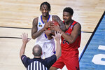 Eastern Washington guard Kim Aiken Jr. (24) and Kansas guard Marcus Garrett, left, battle for the ball during the first half of a first-round game in the NCAA college basketball tournament at Farmers Coliseum in Indianapolis, Saturday, March 20, 2021. (AP Photo/AJ Mast)