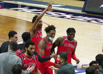 St. John's forwards Isaih Moore (13), Josh Roberts (1) and Marcellus Earlington (10) react after defeating Connecticut in an NCAA college basketball game in Storrs, Conn., Monday, Jan. 18, 2021.  (David Butler II/Pool Photo via AP)