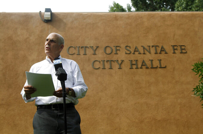 FILE - In this June 17, 2021, file photo, Santa Fe Mayor Alan Webber speaks outside city hall in Santa Fe, N.M. Mayor Webber is confronting local fraternal organizations with accusations of campaign finance violations for unreported spending on political ads in coordination with a rival candidate, as he seeks a second term in office in the November election. Filed on Thursday, Aug. 19, 2021 with a city ethics panel, the complaint from Webber's campaign alleges campaign finance violations by an advocacy group for Spanish-colonial heritage and pride, the Union Protectiva de Santa Fe, and local chapters of the American Legion and Veterans of Foreign Wars. (AP Photo/Cedar Attanasio, File)