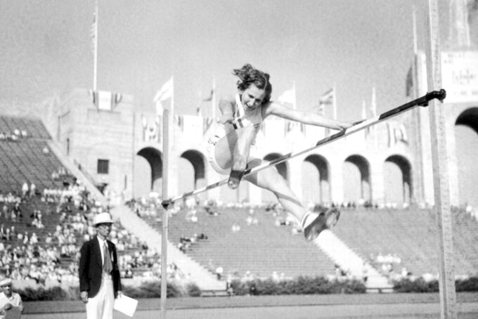 FILE - In this Aug. 7, 1932, file photo, American athlete Jean Shiley, from Philadelphia and captain of the U.S. Women's track and field team, clears the bar at 5 feet, 5 ¼ inches to break the Olympic and world record during at Olympic Stadium in Los Angeles, during the Summer Olympic Games. (AP Photo/File)