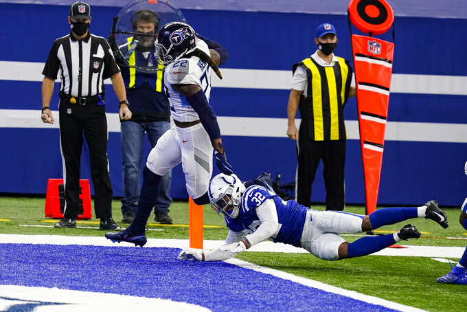 Tennessee Titans running back Derrick Henry (22) gets past Indianapolis Colts free safety Julian Blackmon (32) for a touchdown in the first half of an NFL football game in Indianapolis, Sunday, Nov. 29, 2020. (AP Photo/Darron Cummings)