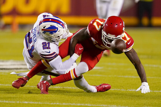 Buffalo Bills safety Jordan Poyer (21) breaks up a pass intended for Kansas City Chiefs wide receiver Mecole Hardman (17) during the first half of an NFL football game Sunday, Oct. 10, 2021, in Kansas City, Mo. (AP Photo/Charlie Riedel)