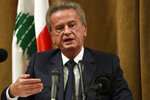 "Riad Salameh, the governor of Lebanon's Central Bank, speaks during a press conference, in Beirut, Lebanon, Nov. 11, 2019. On Monday, Jan. 25, 2021, Lebanon's foreign minister held talks Monday, Jan 25, 2021, with the Swiss ambassador to Beirut after Switzerland started a probe into possible money laundering and embezzlement at the Mideast country's central bank. On Monday, the governor issued a statement saying reports about large transfers ""are very exaggerated and have nothing to do with reality."" (AP Photo/Hussein Malla)"