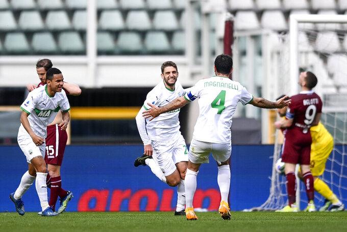 Sassuolo's Domenico Berardi, center, facing camera, celebrates after scoring during the Serie A soccer match between Torino and Sassuolo at the Turin Olympic stadium, Wednesday, March 17, 2021. (Fabio Ferrari/LaPresse via AP)
