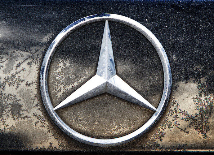 The logo of Daimler is photographed on a car in Frankfurt, Germany, Wednesday, Feb. 6, 2019. Daimler has its annual press conference on Wednesday. (AP Photo/Michael Probst)