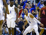 Duke guard Tre Jones (3) reacts after scoring against Virginia Tech during the second half of an NCAA men's college basketball tournament East Region semifinal in Washington, Friday, March 29, 2019. (AP Photo/Patrick Semansky)
