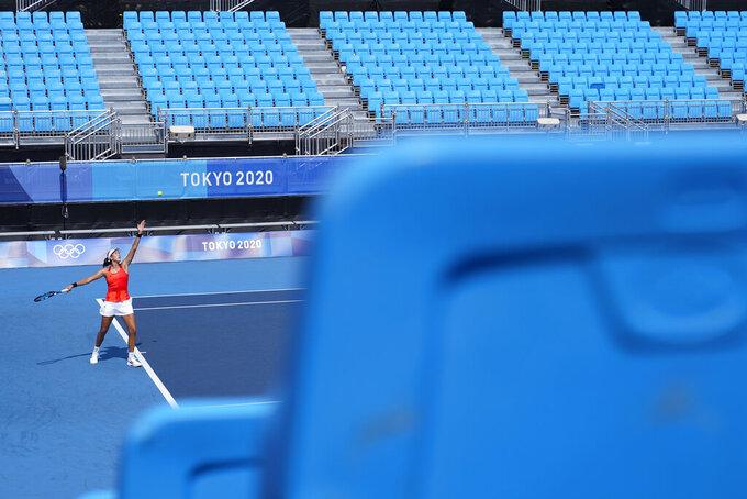Garbine Muguruza, of Spain, serves to Veronika Kudermetova, of the Russian Olympic Committee, during the tennis competition at the 2020 Summer Olympics, Sunday, July 25, 2021, in Tokyo, Japan. (AP Photo/Patrick Semansky)
